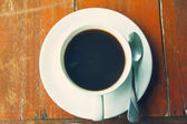 Black coffee in a white cup on the table. — Stock Photo