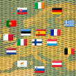 Flags of eurozone countries against piles of coins — Stockfoto