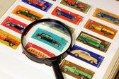 Stamps in an album and magnifying glass — Stock Photo