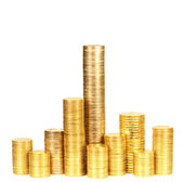 Columns of coins from yellow metal — Stock Photo