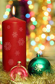 Red candle and Christmas decoration — Stock Photo