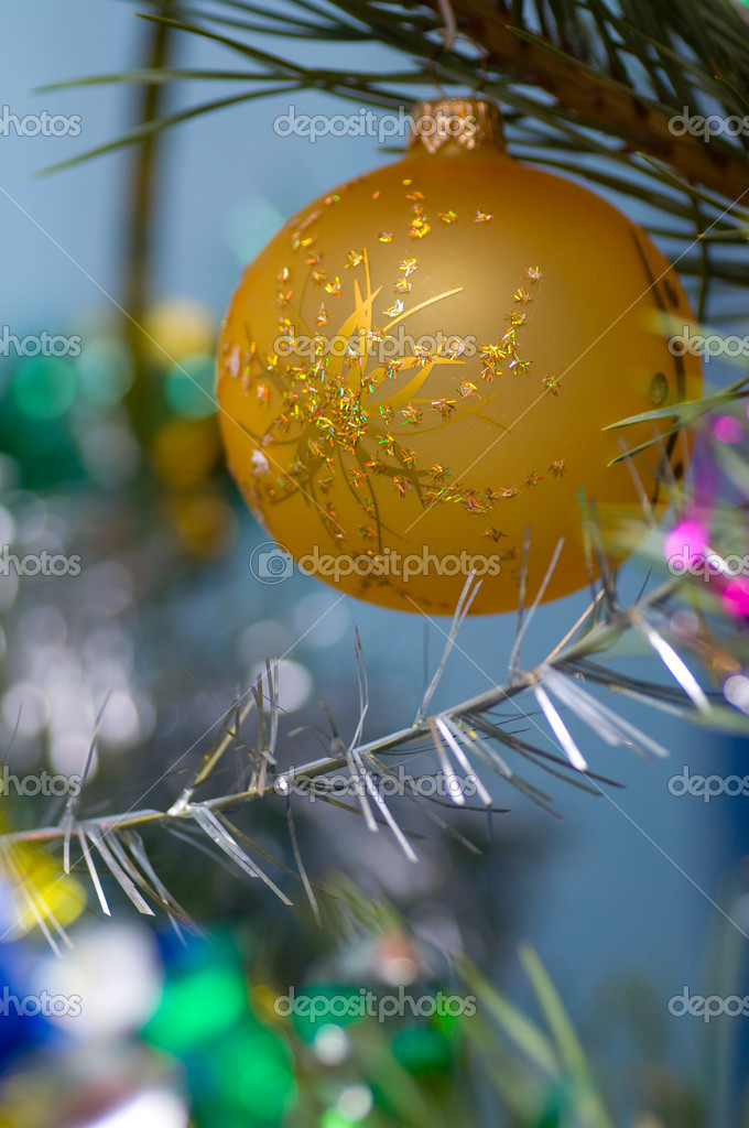 On a green New Year tree color toys hang — Stock Photo #12374689