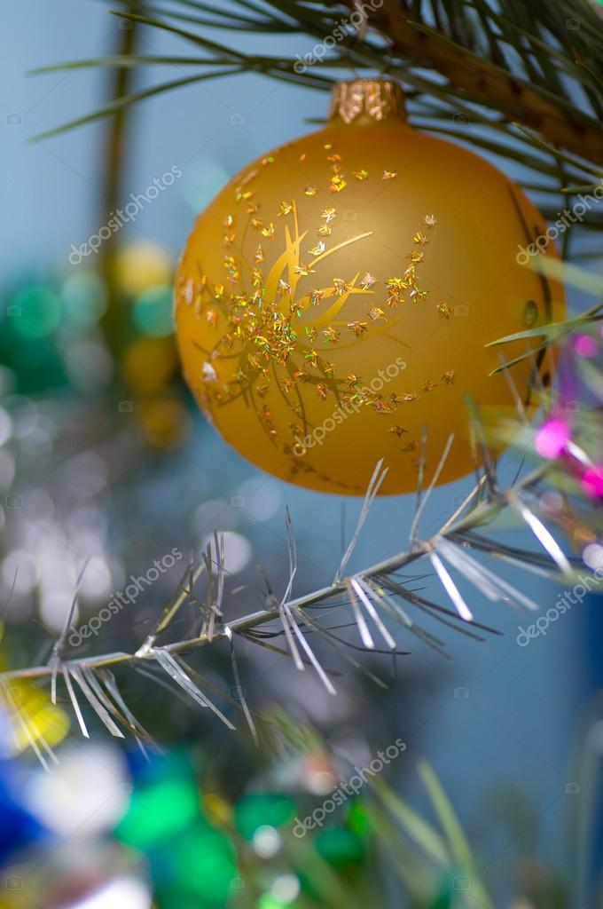 On a green New Year tree color toys hang — Stok fotoğraf #12374689