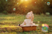 Kid and sun — Stock Photo