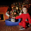 Boy and a Christmas tree — Stockfoto
