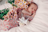 Baby in flowers — Stock Photo