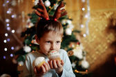 The boy and a fur-tree — Stock Photo
