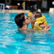 Family rest in pool — Stock Photo