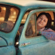 Girl and vintage car — Stock Photo #23354682