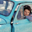 Girl and vintage car — Stock Photo #23352320