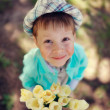 Child with tulips — Stock Photo #24837763