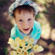 Child with tulips — Stock Photo #24837765