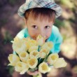 Child with tulips — Stock Photo #24837767