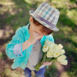 Child with tulips — Stock Photo #24837775