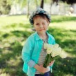 Child with tulips — Stock Photo #24837777