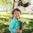 Child with tulips — Stock Photo #24837779