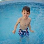 Boy in the pool — Stock Photo