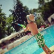 A boy and a pool — Stockfoto