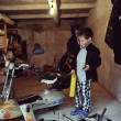 Boy in the garage — Stock Photo