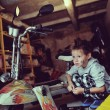 Foto de Stock  : Boy in garage