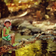 Boy by the river — Stock Photo #32542835