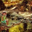 Boy by the river — Stock Photo