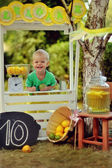 Child with lemons — Stock Photo
