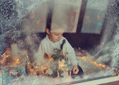 Boy in winter window — Stock Photo