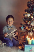 Boy and Christmas tree — 图库照片