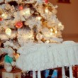 Cot under the Christmas tree — Stock Photo #40224979