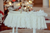 Cot under the Christmas tree — Stock Photo