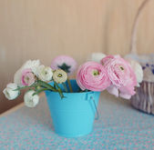 Bouquet in a bucket — Stock Photo