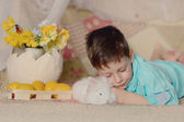 A boy and a white rabbit — Stok fotoğraf