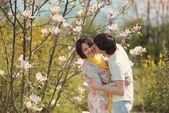 Love and magnolia — Stock Photo