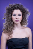 Young and beautiful woman, with curly hair, — Stock Photo