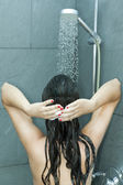 Woman washing her hair — Stock Photo