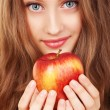 Portrait of a young woman with red apple — Stock Photo