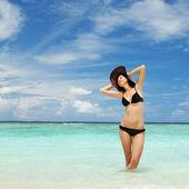 Happy woman on the beach — Stock Photo