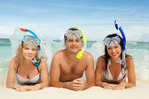 Happy friends with snorkeling equipment on the beach — Stock Photo