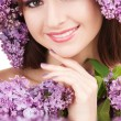 Young woman with lilac flowers — Stock Photo