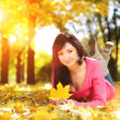 Young pretty woman rest in the autumn park — Stock Photo #13480103