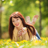 Happy woman with pear in the park — Stock Photo