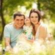 Happy mother, father and daughter in the park — Stock Photo #13666662