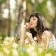 Royalty-Free Stock Photo: Cute woman in the park with dandelions