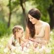 Mother communicate with daughter in the park — Stock Photo