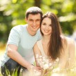 Young happy couple in the park — Foto de Stock
