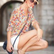 Stock Photo: Young fashion woman in old city