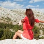 Beautiful woman sitting before the mountains. Life's enjoyment — Stock Photo #14529959