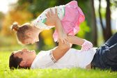 Father and daughter in the park — Stok fotoğraf