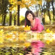 Young pretty woman rest in the autumn park  — Stock Photo #14530041